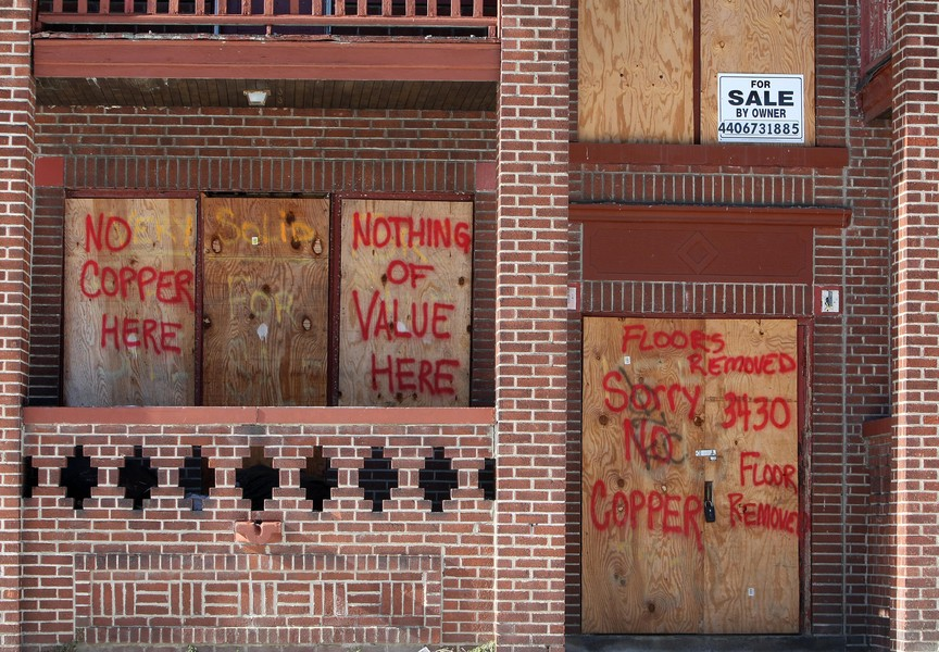 The front of a boarded up building in th
