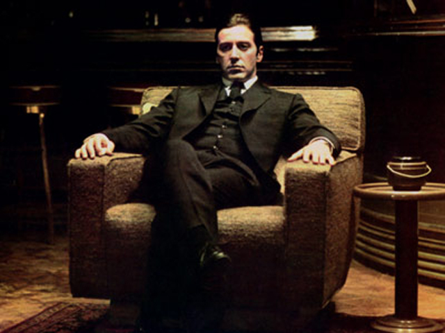 THE GODFATHER: PART II, Al Pacino, 1974, sitting in a chair
